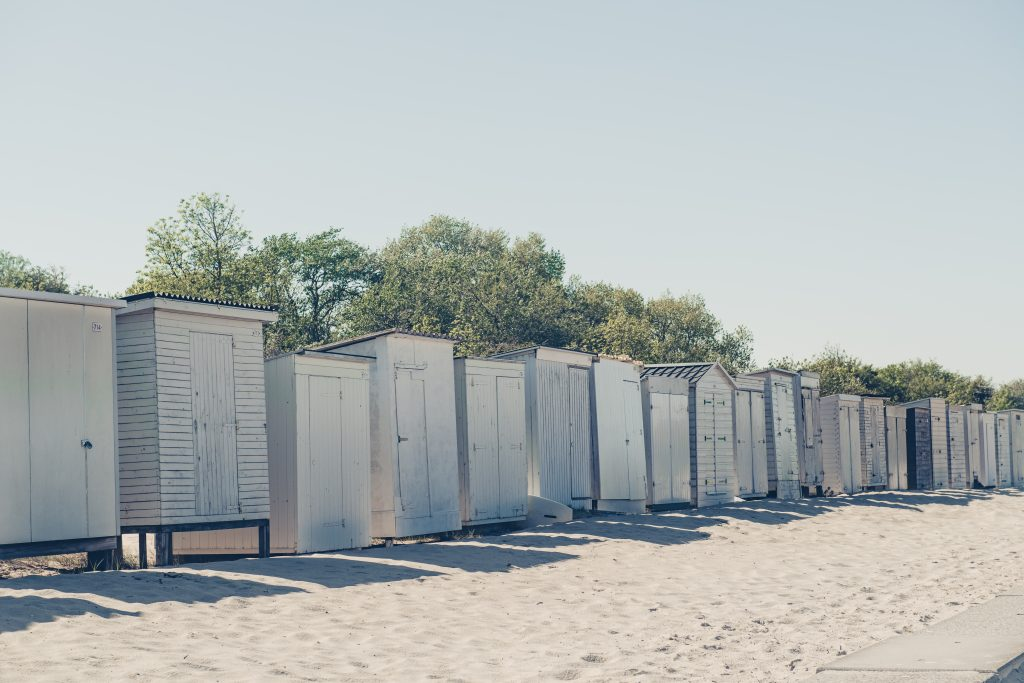 Changing rooms on the sandy beach.